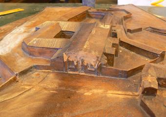 Plastico di Bergamo Alta in legno del 1934. Particolare della facciata danneggiata della Chiesa di Sant'Agostino.